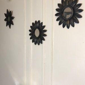 Three wall mirrors